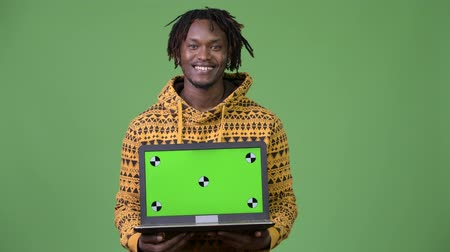 barba : Young handsome African man showing laptop