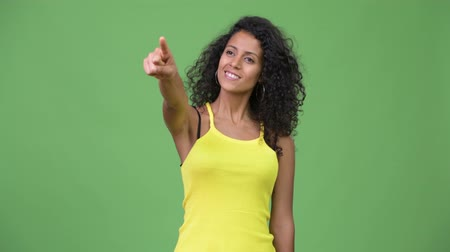 kolsuz : Young beautiful Hispanic woman pointing finger