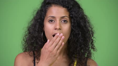 covering : Young beautiful Hispanic woman looking shocked Stock Footage