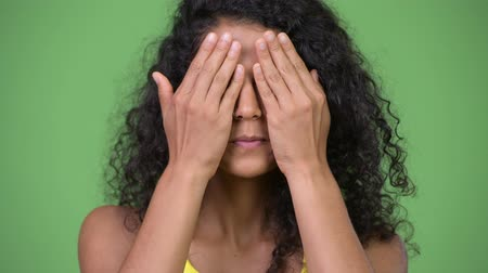 covering : Young beautiful Hispanic woman covering eyes as three wise monkeys concept Stock Footage