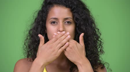 bölcs : Young beautiful Hispanic woman covering mouth as three wise monkeys concept