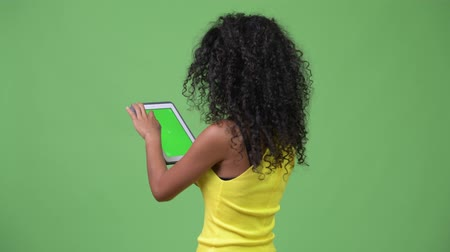 kolsuz : Young beautiful Hispanic woman using digital tablet