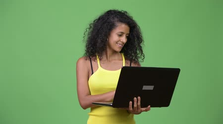 kolsuz : Young beautiful Hispanic woman thinking while using laptop