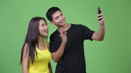 together trust : Young happy Asian couple video calling together