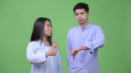 together trust : Young Asian business couple having different decisions together Stock Footage