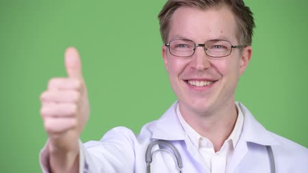 хороший : Young Man Doctor Making Thumb Up Gesture Стоковые видеозаписи
