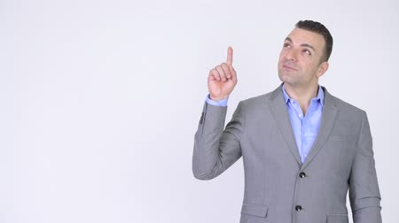 chefia : Businessman Pointing And Showing Copyspace Against White Background