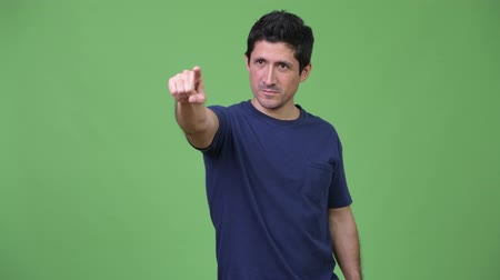 indicating : Hispanic man thinking while pointing finger
