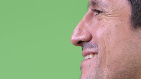 перуанский : Close-up side view of Hispanic man smiling Стоковые видеозаписи