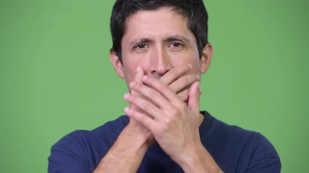 bilge : Hispanic man covering mouth as three wise monkeys concept