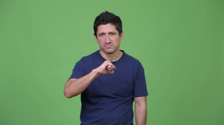 no hands : Sad Hispanic man giving thumbs down Stock Footage