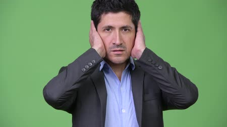 bölcs : Hispanic businessman covering ears as three wise monkeys concept