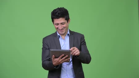 перуанский : Happy Hispanic businessman using digital tablet Стоковые видеозаписи