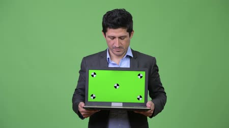 перуанский : Happy Hispanic businessman showing laptop Стоковые видеозаписи