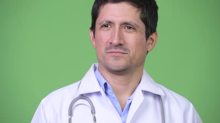 perui : Close up of Hispanic man doctor thinking