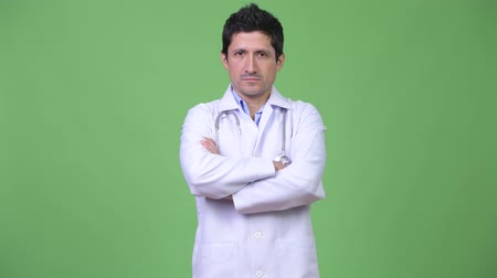 crossed : Hispanic man doctor smiling with arms crossed