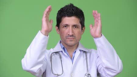 bilge : Hispanic man doctor covering ears as three wise monkeys concept