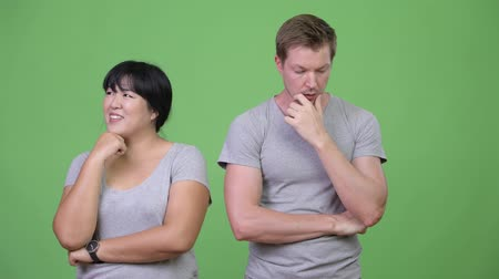 thought : Young multi-ethnic couple thinking differently together