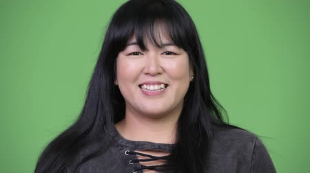 attitude : Head shot of beautiful overweight Asian woman smiling