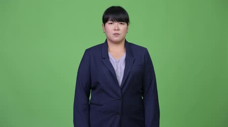excesso de trabalho : Beautiful overweight Asian businesswoman