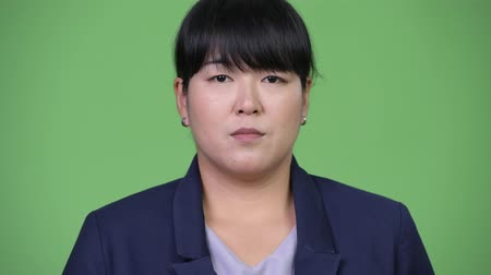 excesso de trabalho : Head shot of beautiful overweight Asian businesswoman