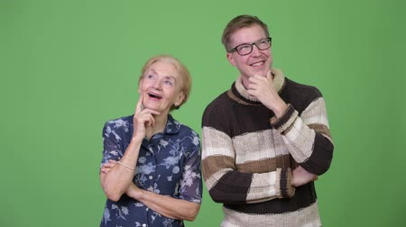 finnish : Happy grandmother and grandson thinking together Stock Footage
