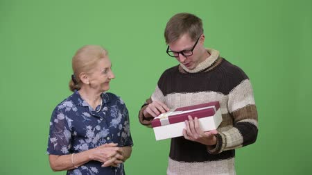 unokája : Grandson getting gift from grandmother with nothing inside