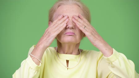 sayings : Beautiful senior businesswoman covering eyes as three wise monkeys concept