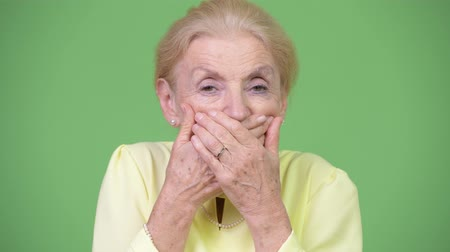 sayings : Beautiful senior businesswoman covering mouth as three wise monkeys concept