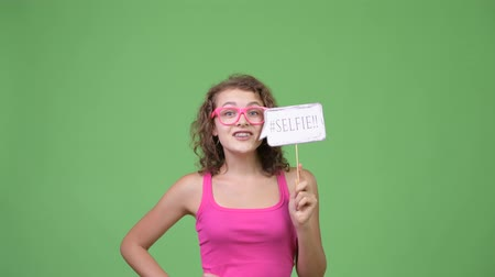 kolsuz : Young happy beautiful nerd woman with selfie paper sign