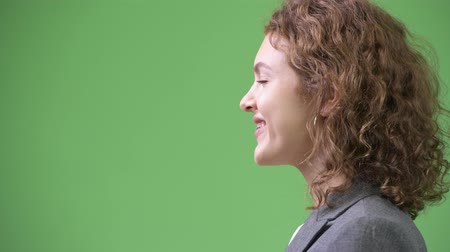 braces : Profile view of young beautiful businesswoman with curly blond hair smiling Stock Footage