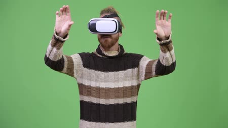 rastafarian : Happy handsome bearded man using virtual reality headset Stock Footage