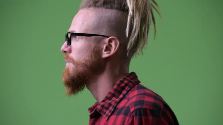 rastafarian : Profile view of handsome bearded hipster man with dreadlocks looking up Stock Footage