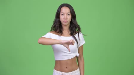 disapprove : Young angry multi-ethnic woman giving thumbs down Stock Footage