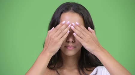 sayings : Young beautiful multi-ethnic woman covering eyes as three wise monkeys concept