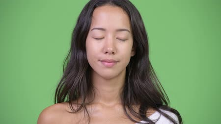 multikulturní : Young happy beautiful multi-ethnic woman relaxing with eyes closed