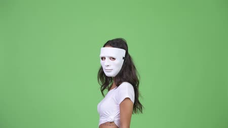disguise : Young multi-ethnic woman wearing mask and looking back