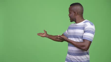 chroma key : Young happy African man showing something