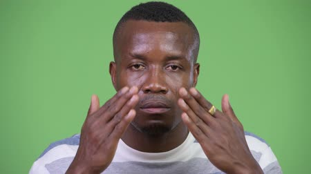 bilge : Young African man covering eyes as three wise monkeys concept