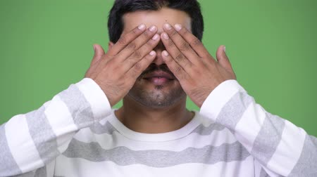 bölcs : Young handsome Persian man covering eyes as three wise monkeys concept Stock mozgókép
