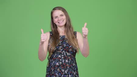 polegar : Young happy pregnant woman giving thumbs up and looking excited Stock Footage