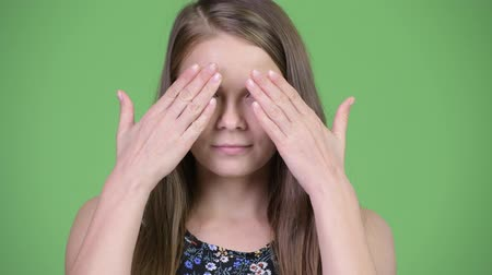 bilge : Head shot of young beautiful woman covering eyes as three wise monkeys concept