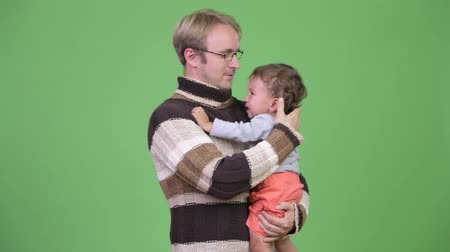 crying baby : Studio shot of father holding his crying baby son