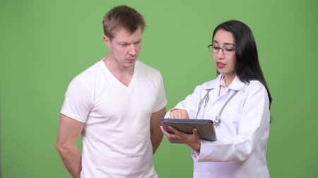 fince : Young Asian woman doctor giving consultation to young man patient