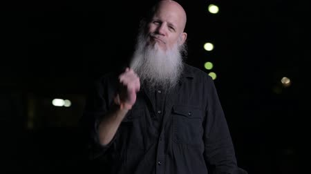brushing : Portrait Of Bald Man With Gray Beard Outdoors At Night Stock Footage