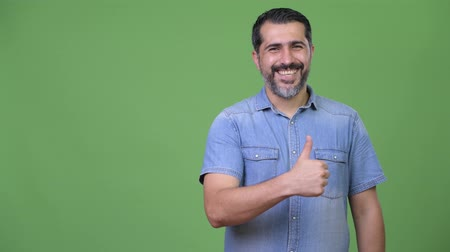 brim : Handsome Persian bearded man giving thumbs up Stock Footage