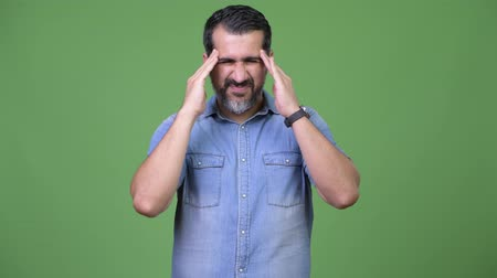 denim : Handsome Persian bearded man having headache