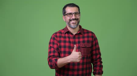 tiro do estúdio : Handsome Persian bearded man giving thumbs up Stock Footage