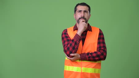 hand on chin : Handsome Persian bearded man construction worker thinking