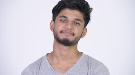 ponderar : Young stressed bearded Indian man looking bored